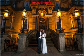 Front of the Grand Hotel in Tynemouth night time bride and groom portrait