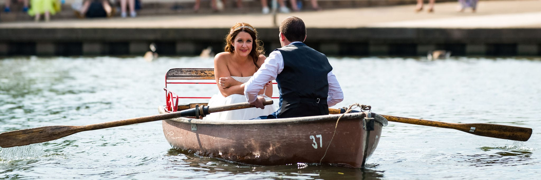 bride and groom on a rowing boat in stratford-upon-avon