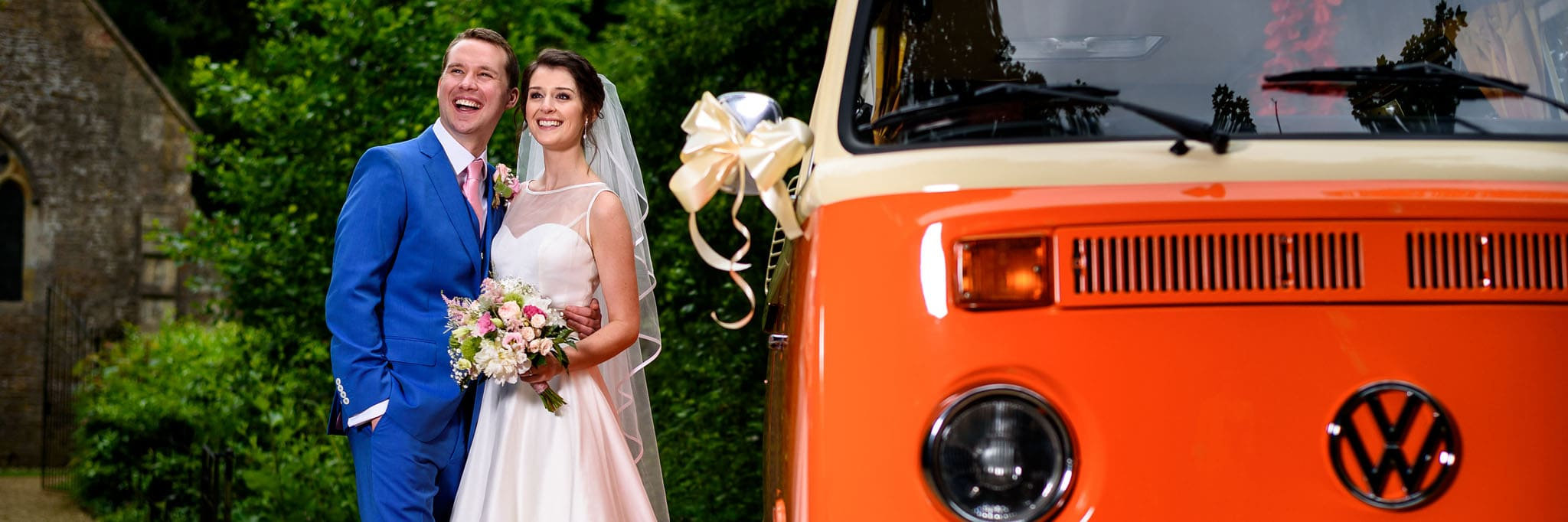 the happy couple next to a vintage VW camper van