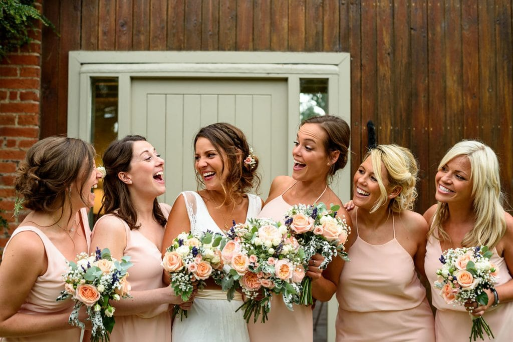 bride and bridesmaids having a good laugh