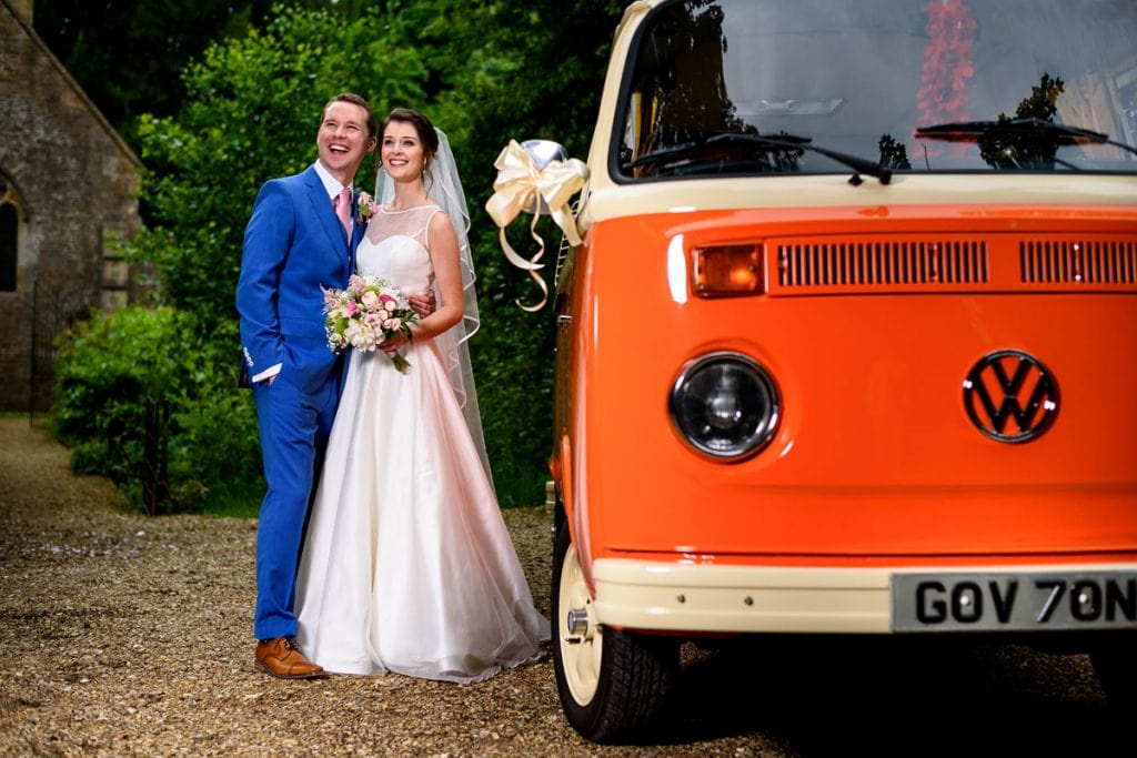 bride and groom with a vintage vw camper van