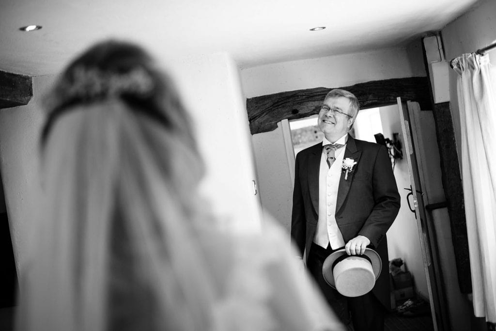 the bride's dad walks in to see his daughter in her wedding dress