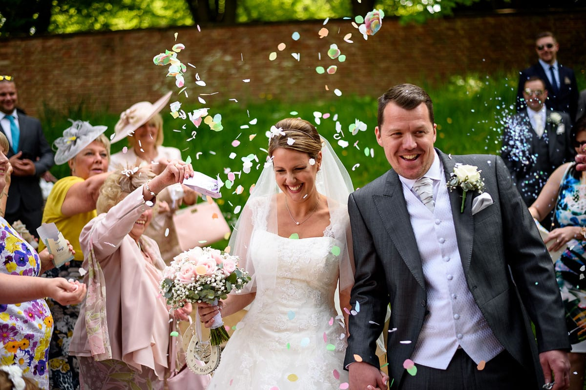 confetti shower for the bride and groom at their summer wedding