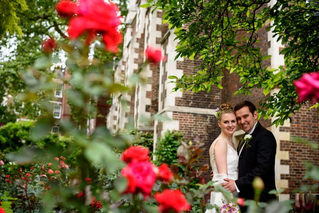 bride and groom in the rose gardens at middle temple
