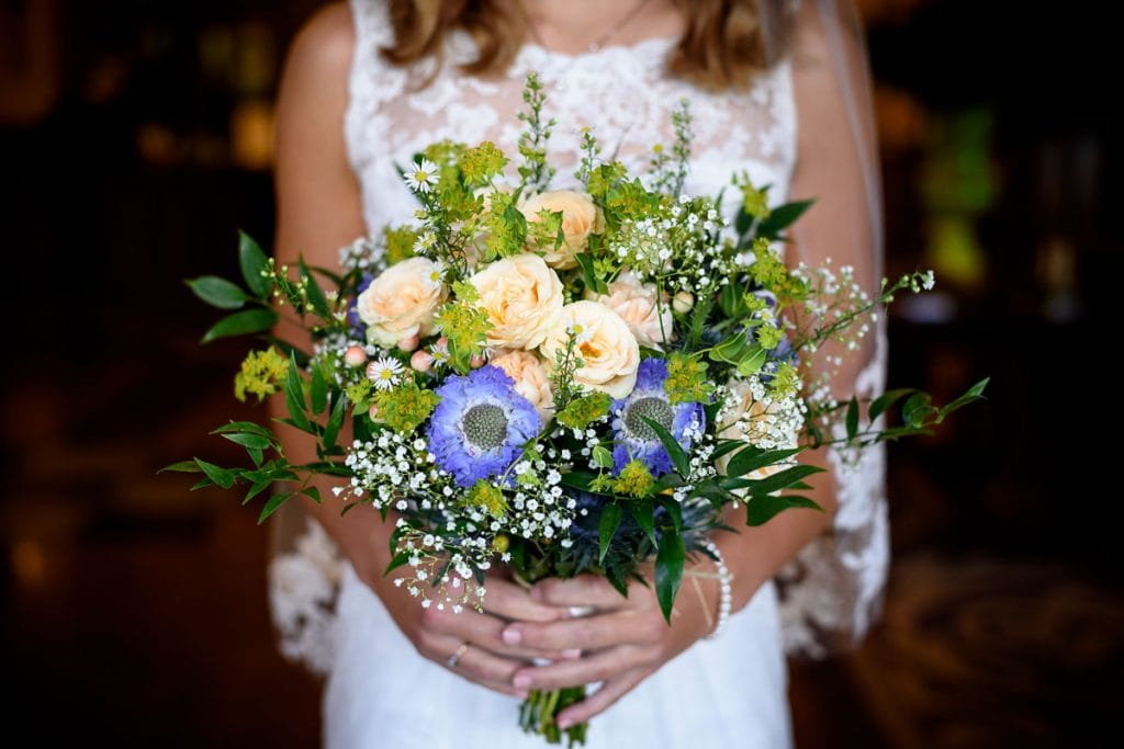 stunningly colourful bouquet being held by the bride