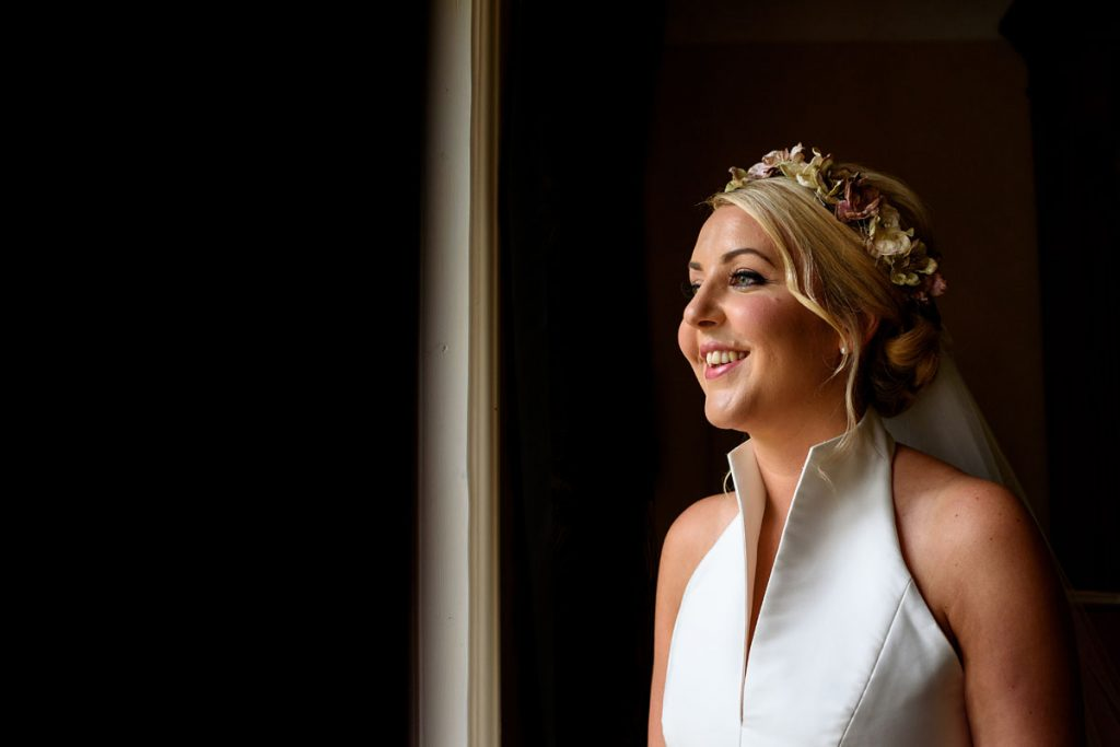 a smiling bride in the lovely window light