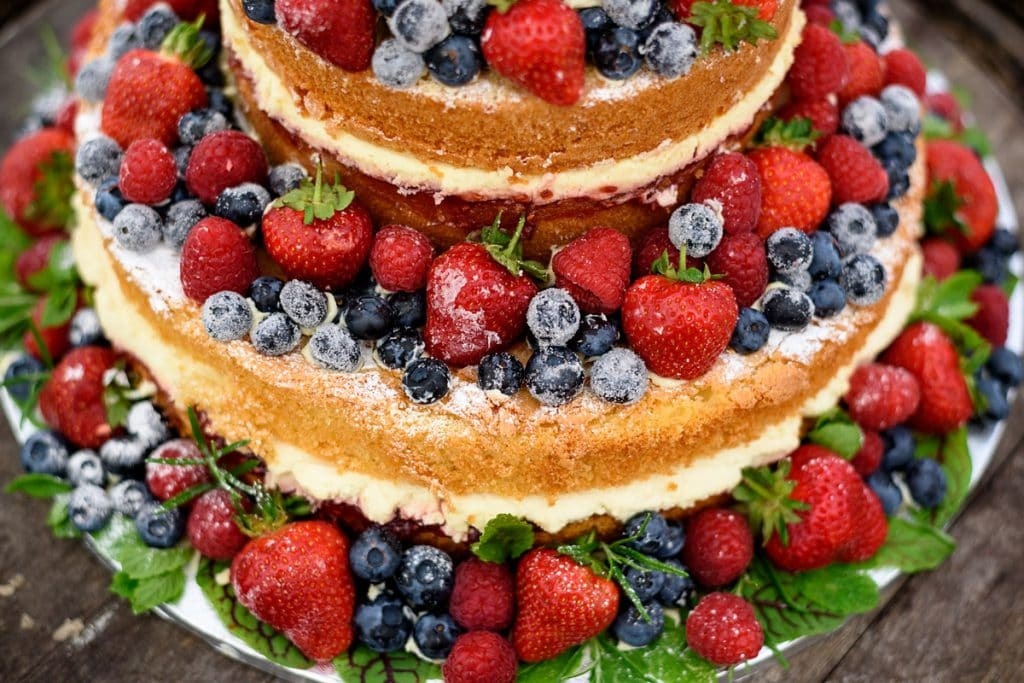 stunning naked summer fruits wedding cake