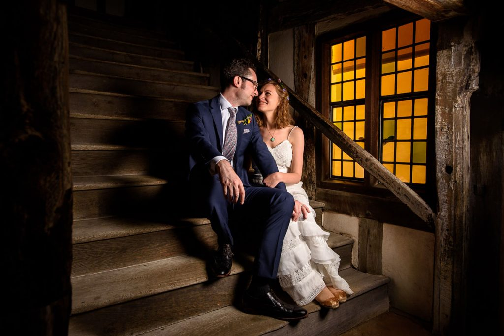 night portrait of the bride and groom on the stairs at lord leycester hospital