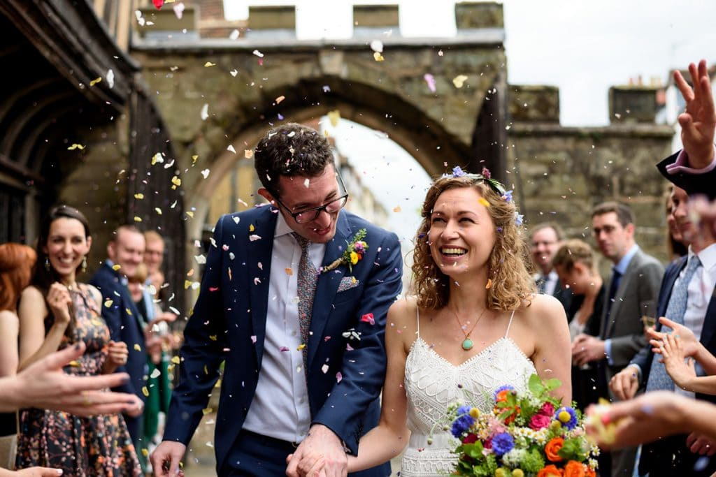 confetti being thrown over the bride and groom at lord leycester hospital