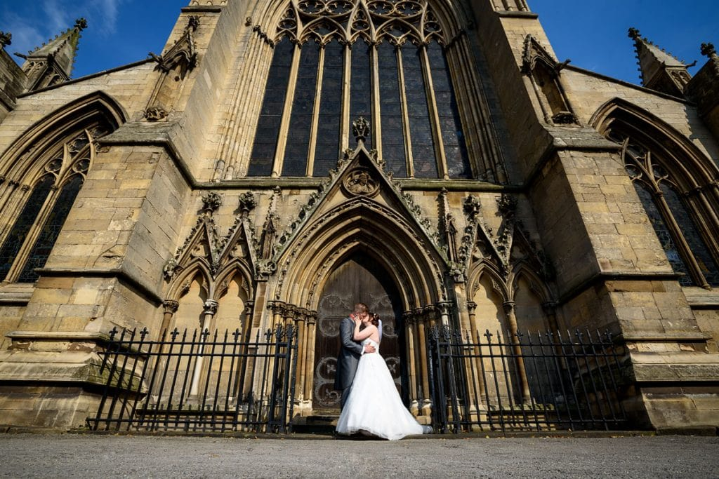 bride and groom kissing outside doncaster minster