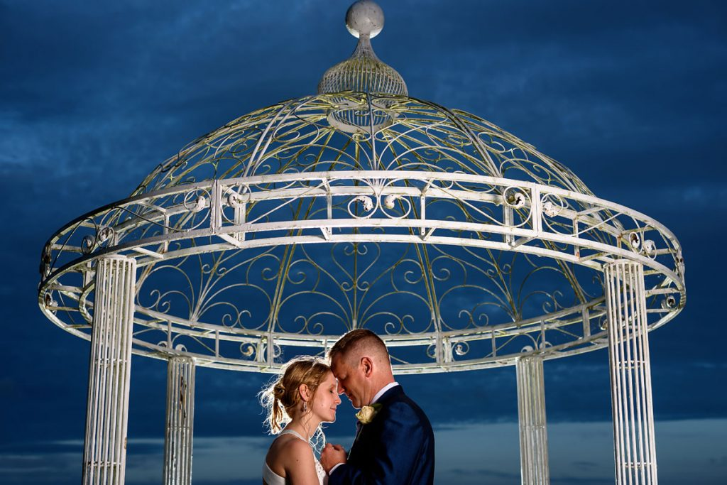 night shot of the bride and groom under the pagoda at draycote hotel