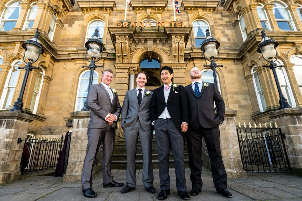 the groomsmen outside grand hotel in tynemouth