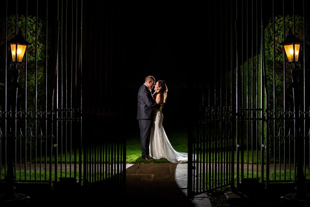 night time portrait of the bride and groom at wroxall abbey