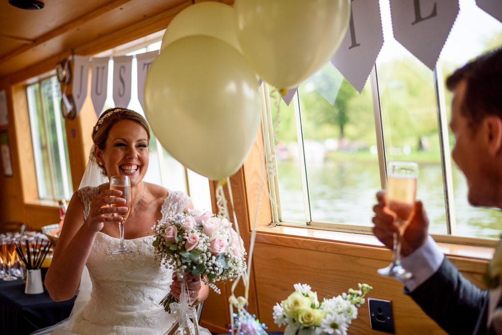 a very happy bride on a wedding day boat trip in stratford-upon-avon
