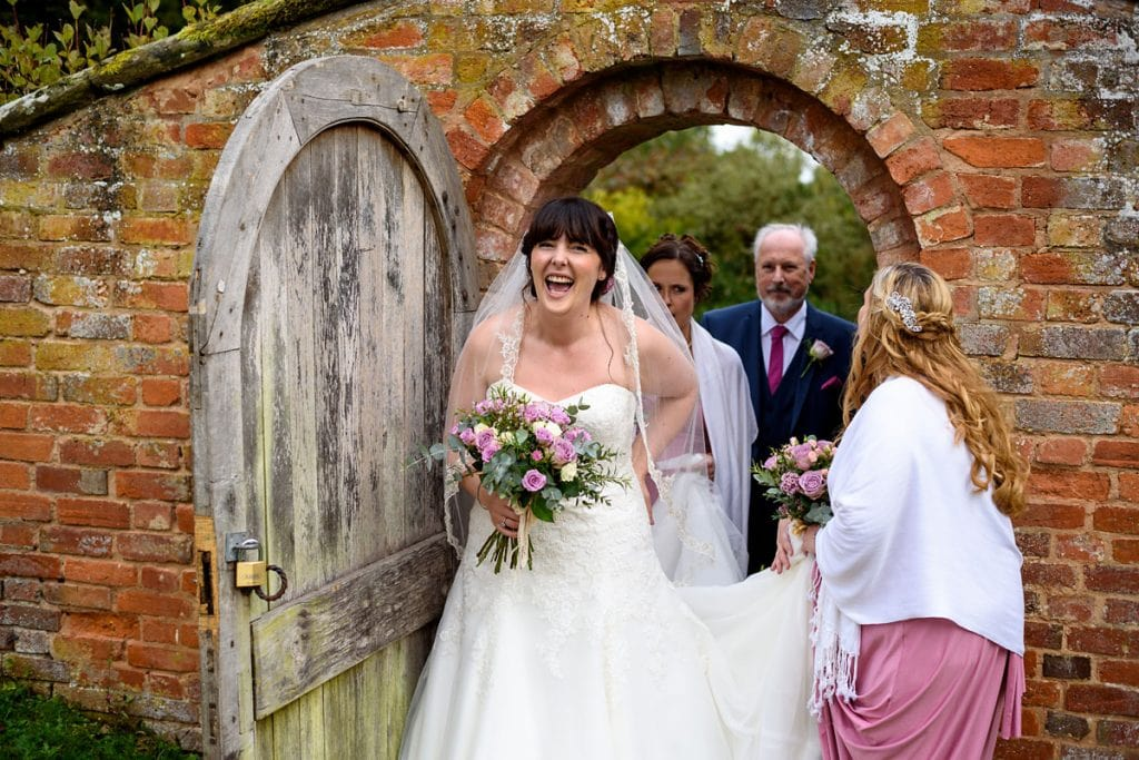 a very excited bride walking to the church