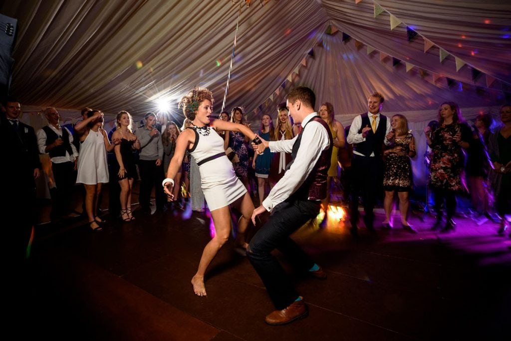 a man and woman take centre stage on the dance floor