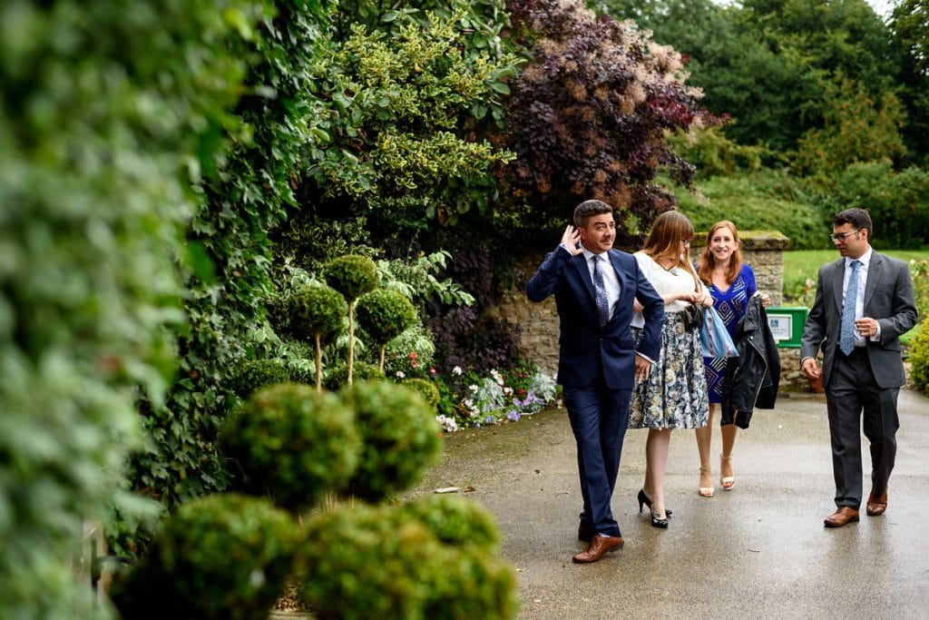 wedding guests strikes a pose arriving at mallory court