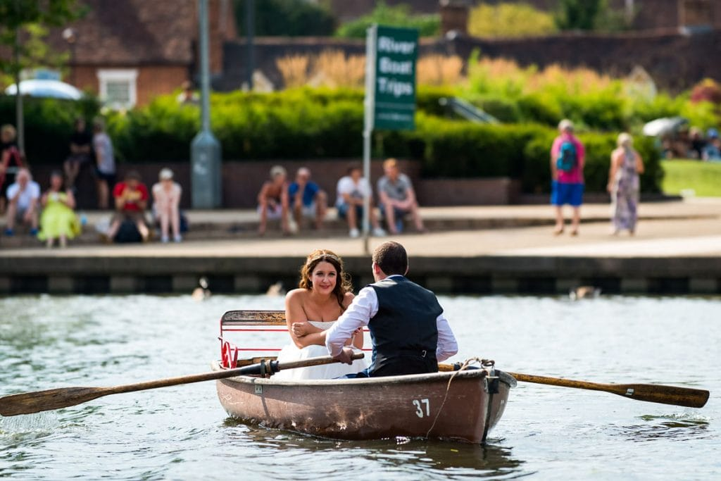 bride and groom on a rowing boat in the centre of stratford-upon-avon