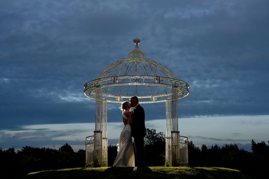 wide shot of the bride and groom under the pagoda at draycote hotel