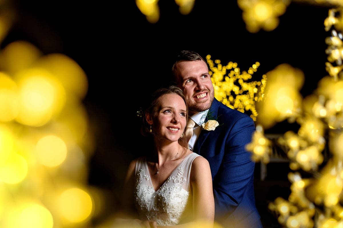bride and groom surrounded by sparkly lights