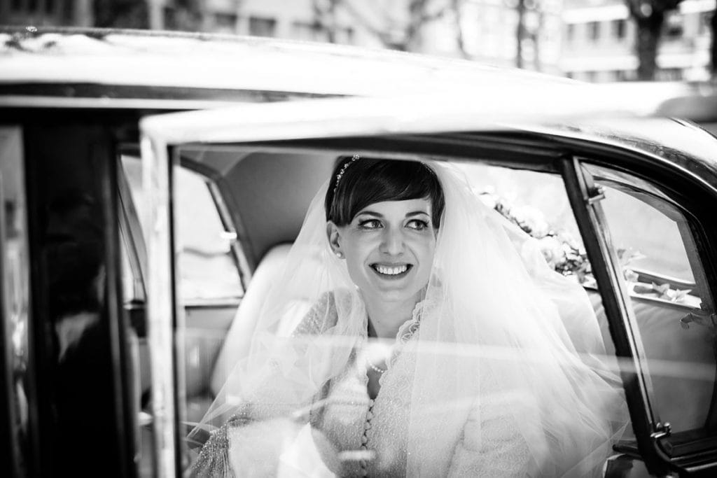 bride waiting in her vintage wedding car