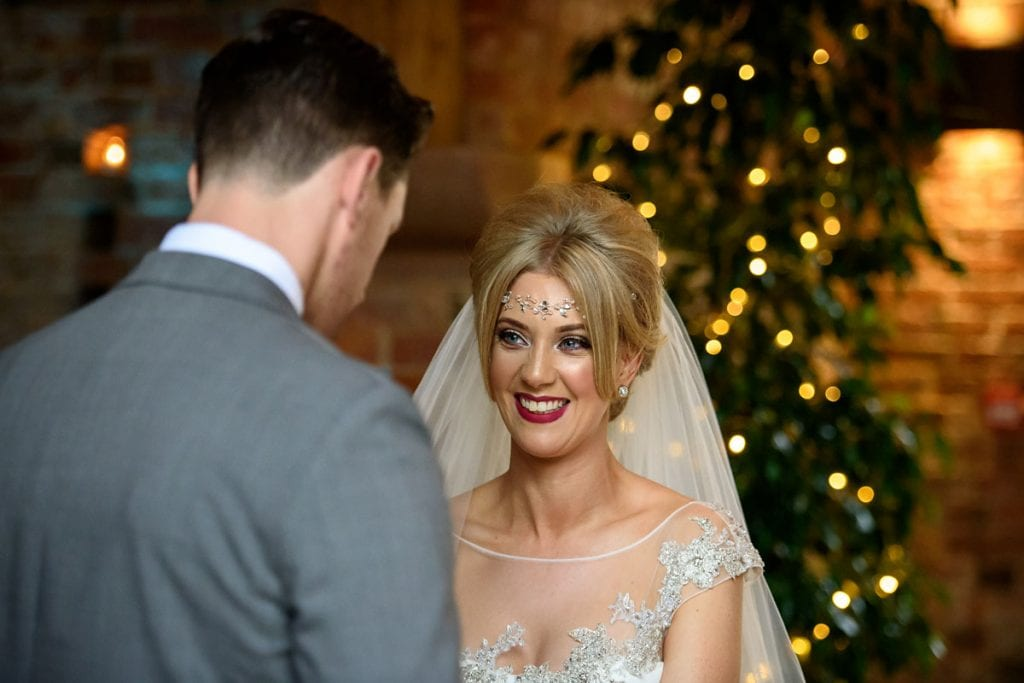 bride looking lovingly at the groom during the ceremony