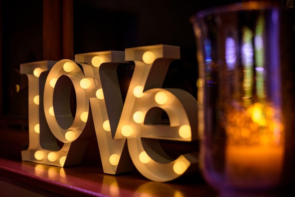 light up love sign at the wedding reception
