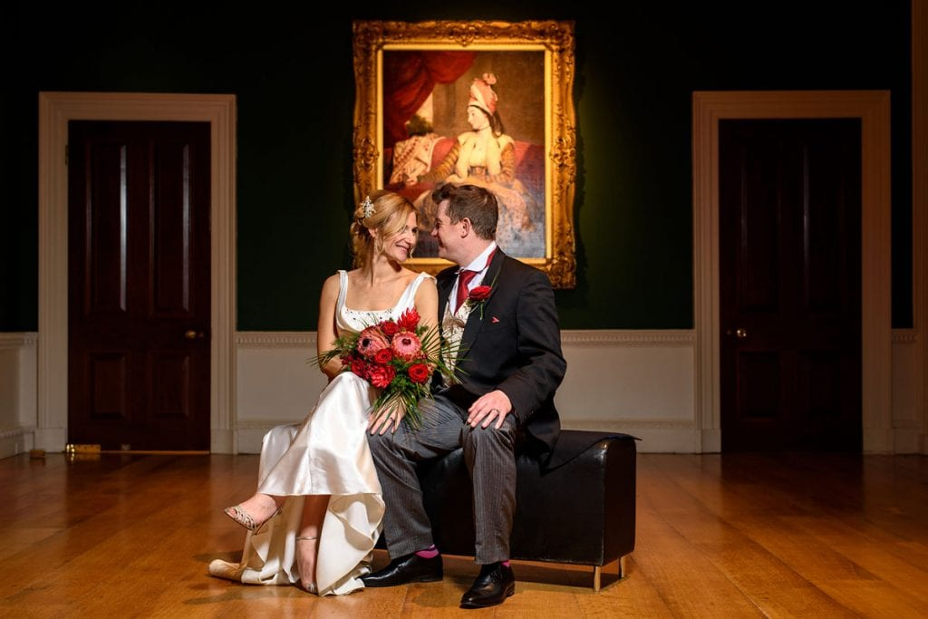 bride and groom portrait inside the art gallery at compton verney