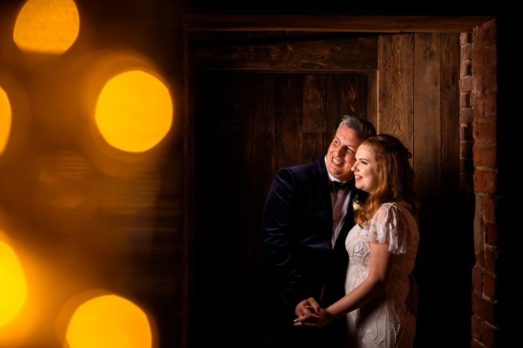 bride and groom night time portrait with fairy lights