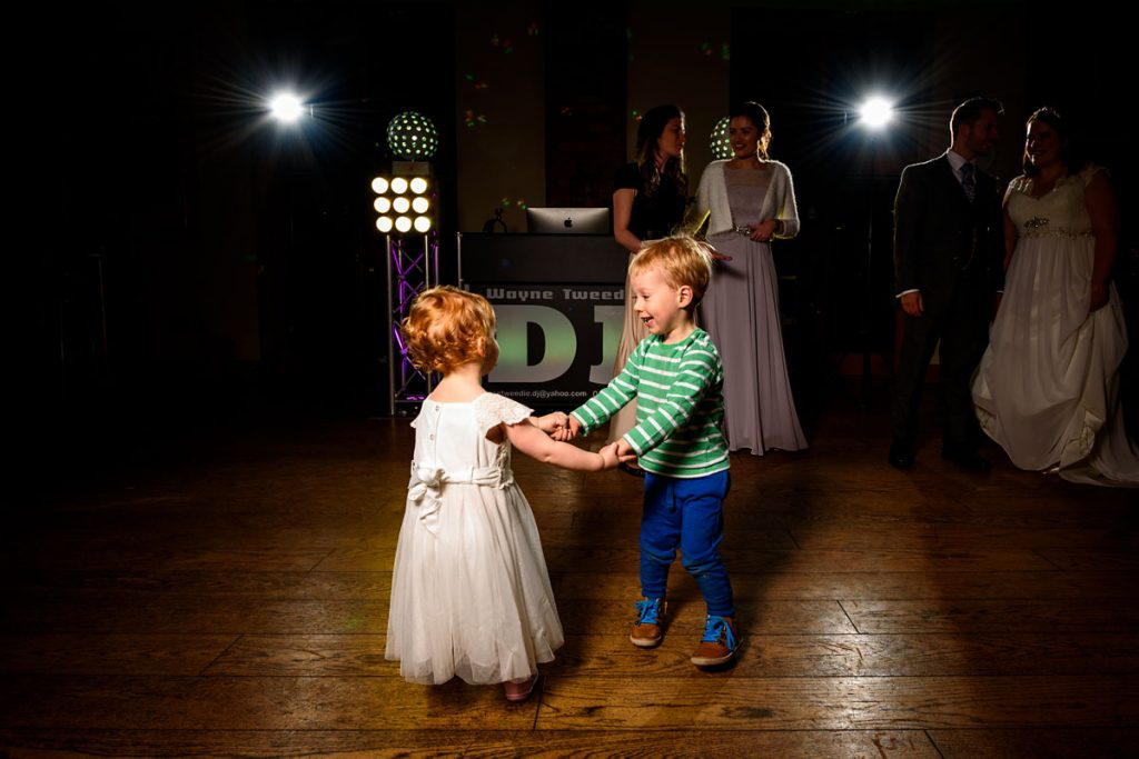 flower girl and page boy dancing together on the dance floor