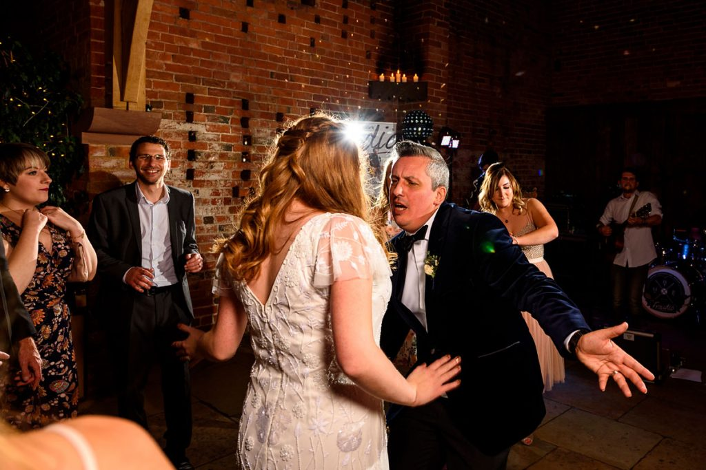 the dance floor in full swing as the bride and groom show off their moves