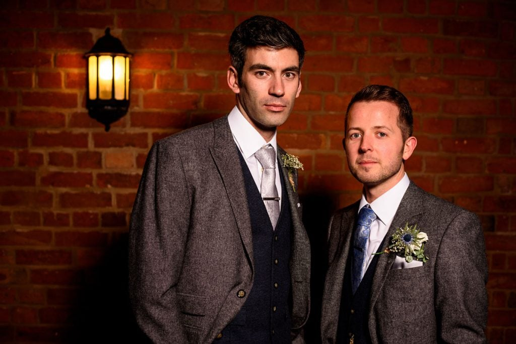 night time shot of the groom and his best man at wootton park