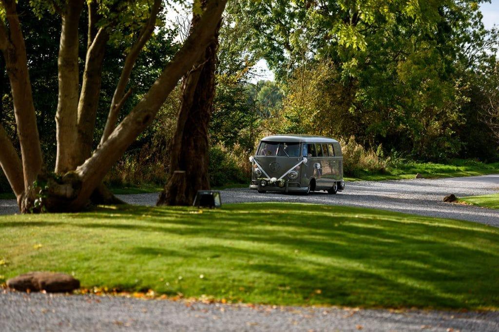 vintage vw camper van arriving for the wedding at shustoke farm barns