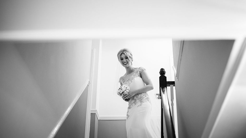 the bride about to walk down stairs ready for her wedding