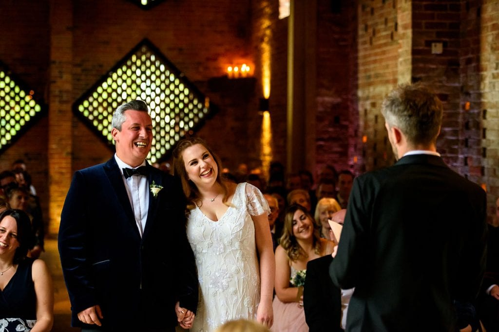 all smiles for this bride and groom during their ceremony at shustoke farm barns