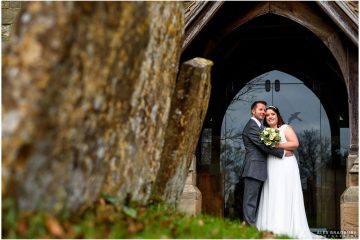 bride and groom portrait in the church doorway