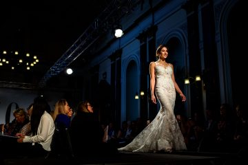 model kate thomas on the catwalk in a beautiful detailed enzoani dress