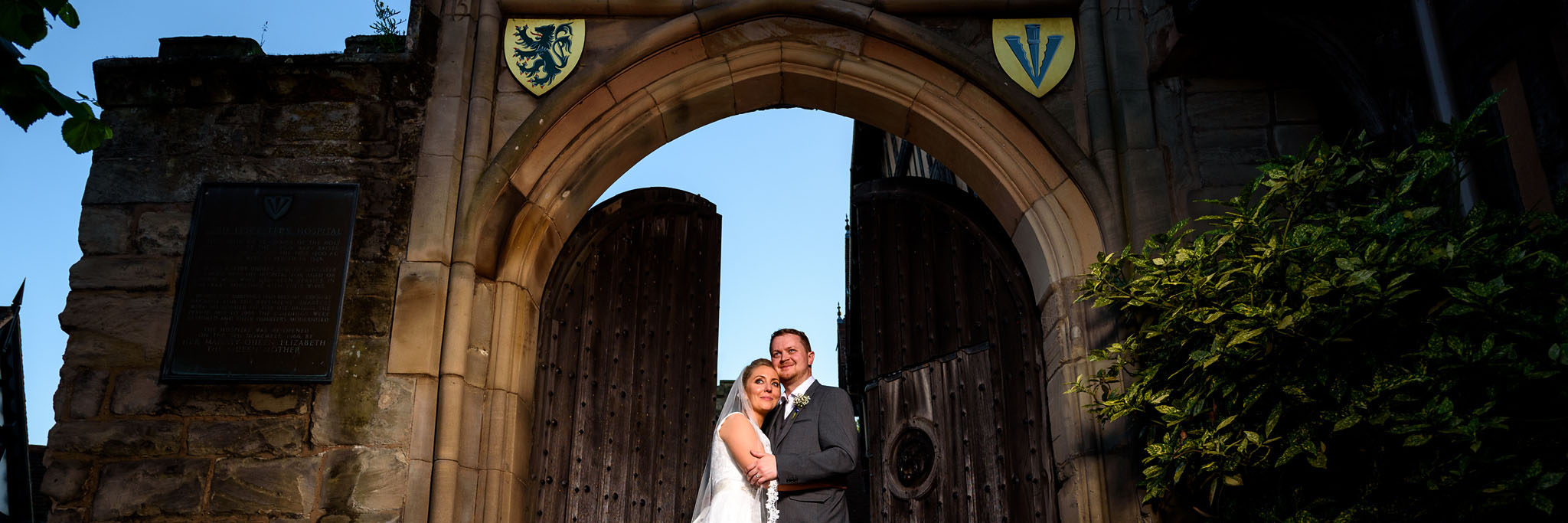 evening portrait of the bride and groom outside lord leycester hospital