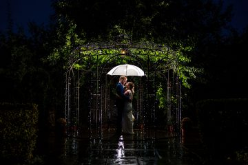 bride and groom rain shot at wethele manor