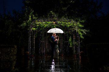 bride and groom rain shot at wethele manor