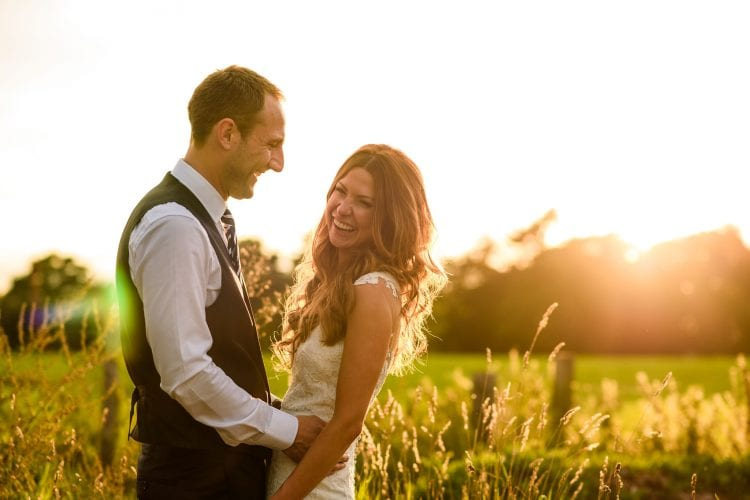 bride and groom holding each other during a sunset portrait