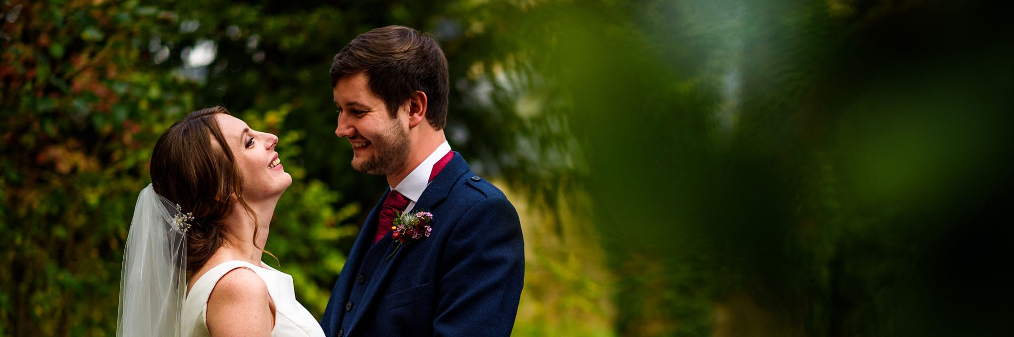 portrait of the bride and groom surrounded by autumnal gardens