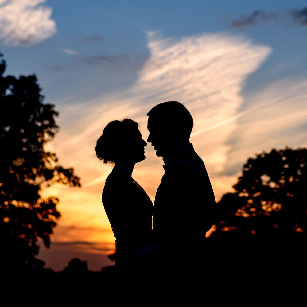 sunset silhouette of the bride and groom