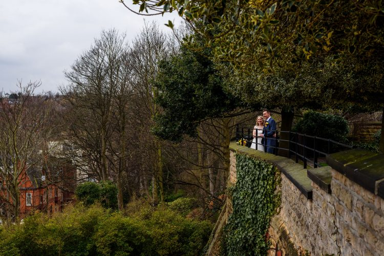 bride and groom looking out over the views of nottingham