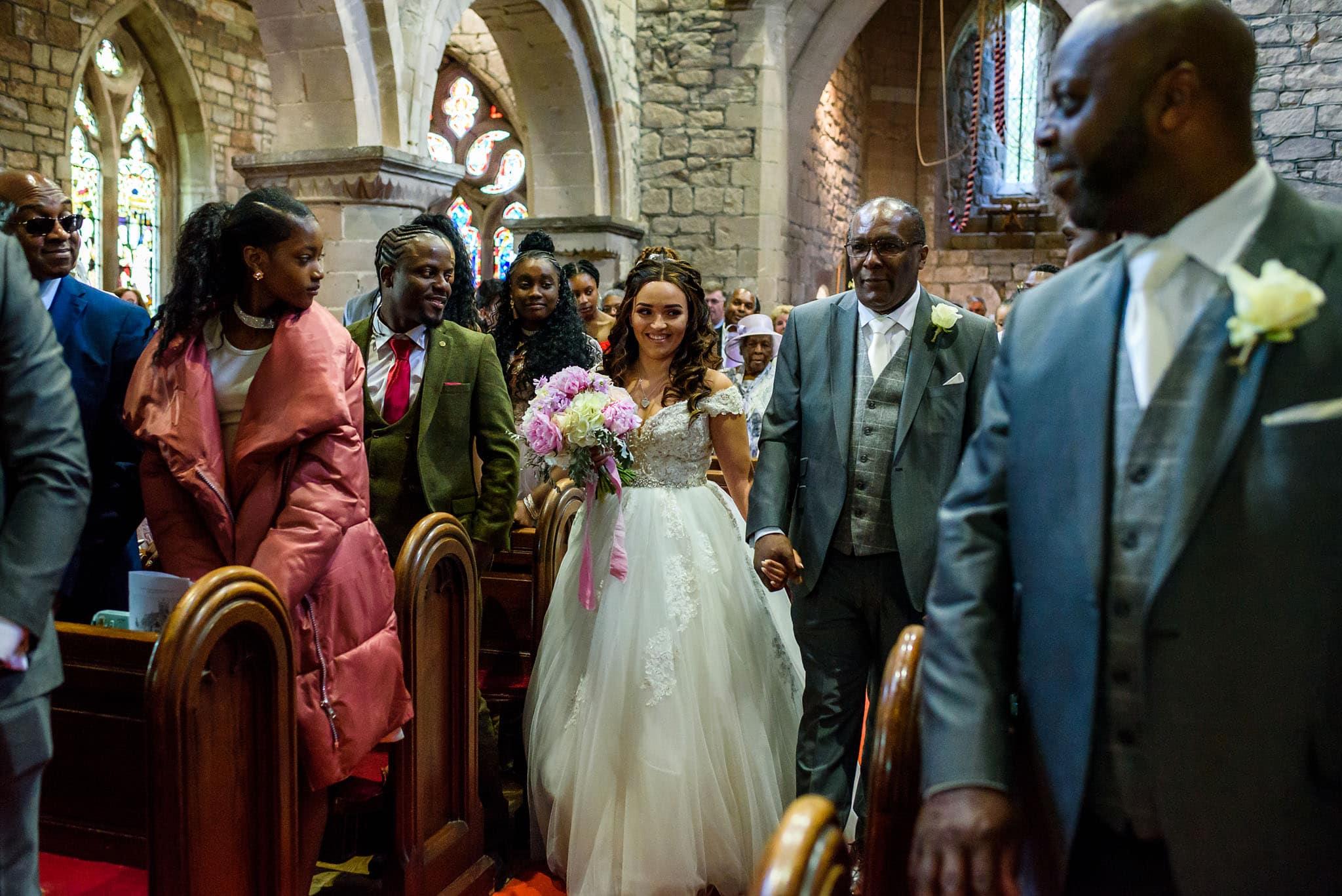 bride walking down the aisle in saint mary's church
