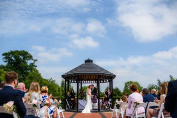 first kiss at the outdoor wedding ceremony at ardencote