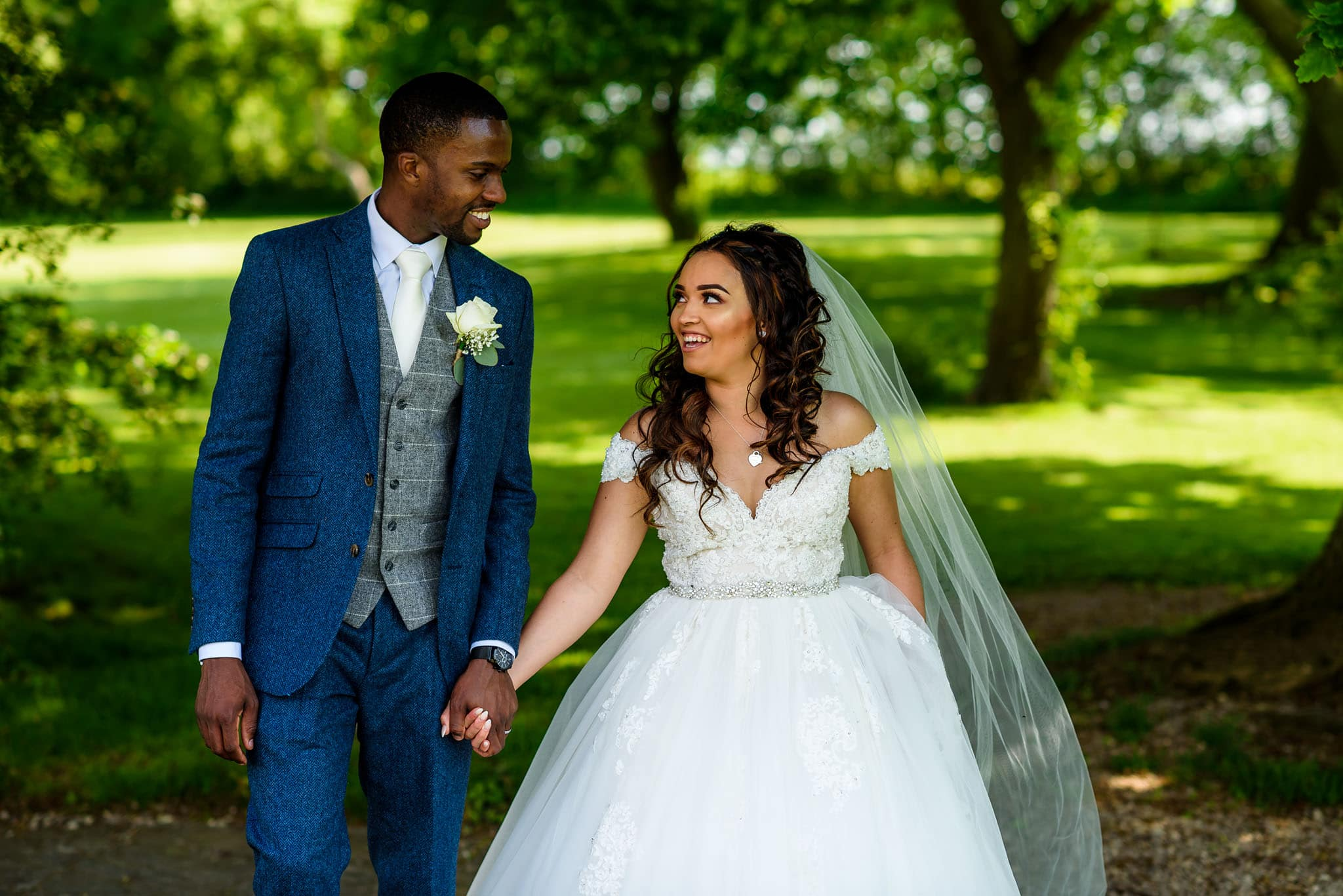 bride and groom walking through the gardens at wethele manor