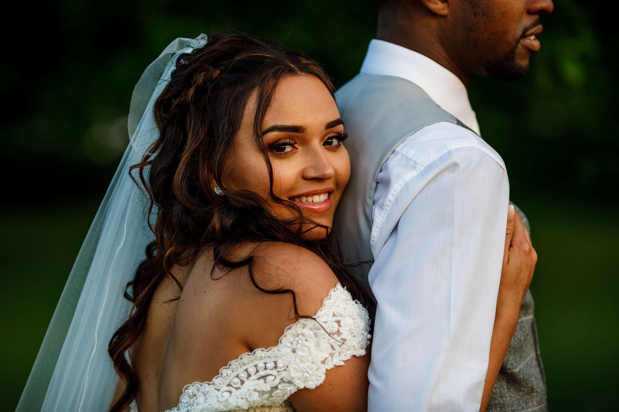 the bride hugging the groom