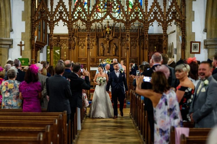 bride and groom walking back down the aisle