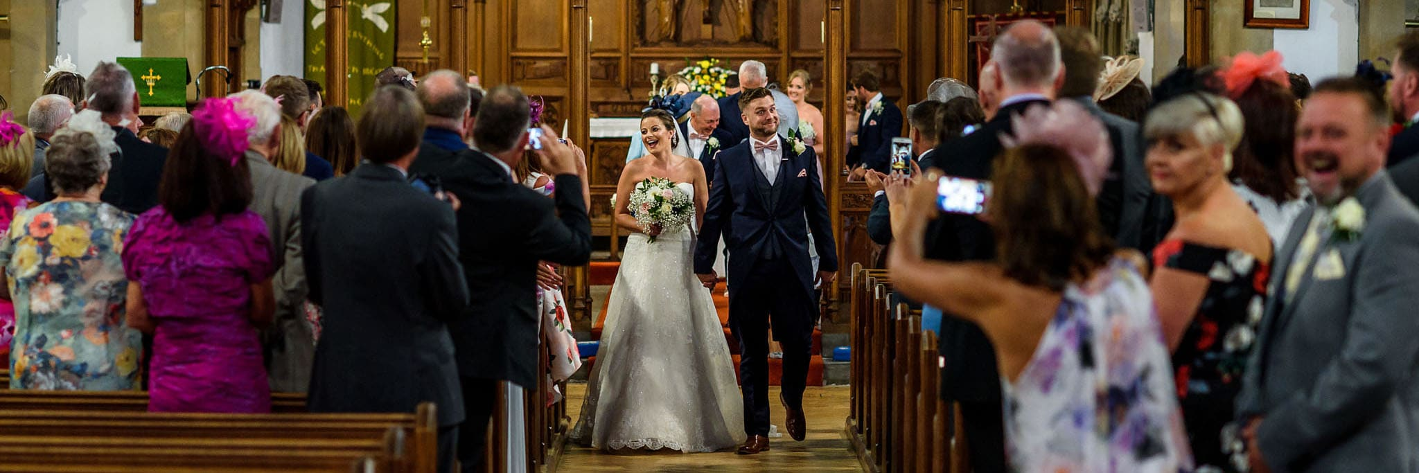 the happy couple walking back down the aisle